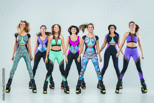 the group of young girls jumping on kangoo training. Black Bedroom Furniture Sets. Home Design Ideas