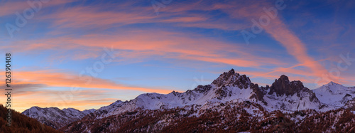 Fotomurales Colorful sunrise and snow covered mountains during an autumn morning in the Claree valley, France.