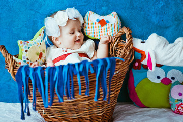 The baby lies in the basket