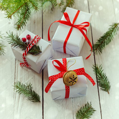 White boxes decorated red ribbon and Metal Jingle Bell. Christmas Holiday Decoration