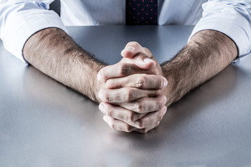 anonymous leader hands waiting or thinking at meeting or interview
