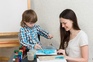 mother with boys son paint colors at home