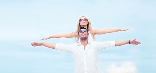 couple holding hands up at sea side