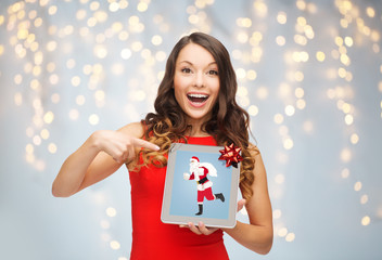woman s with santa claus on tablet pc screen