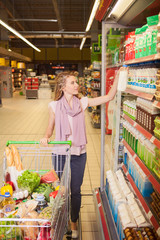 Young woman shopping and choosing goods