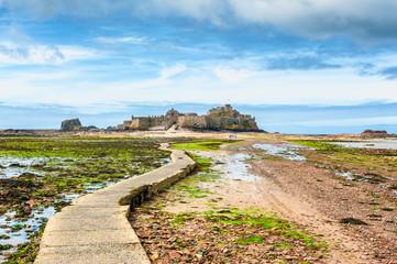 Low Tide footpath leading to Elizabeth Castle, off the coast of Saint Helier,  Jersey, Channel Islands, UK.