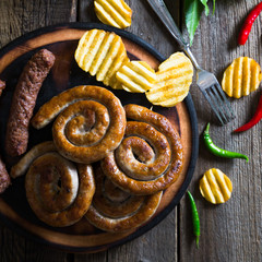 Grilled sausages, potato chips and beer