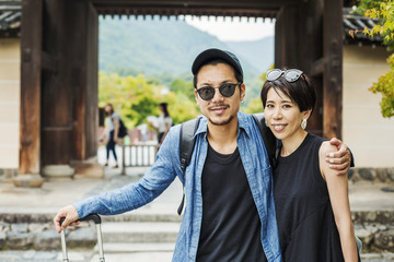 A man and woman visiting a historic temple in Japan.