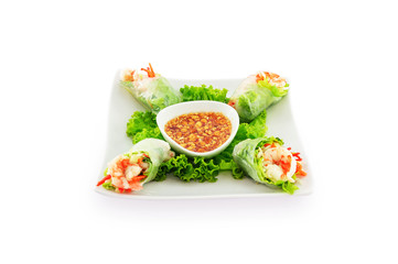 Raw spring rolls with shrimp in white plate isolated