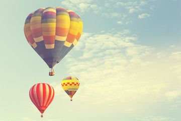 Hot air balloon on sun sky with cloud, vintage and retro instagram filter effect style