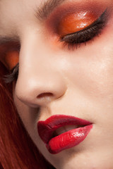 Close up portrait of girl with red make up