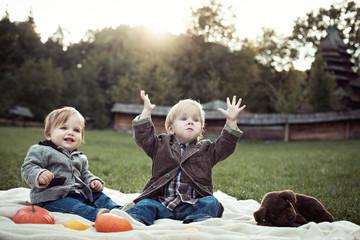 Beautiful cute children play in the garden