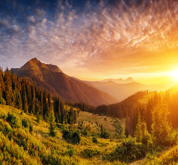 Wall Mural - Picturesque view of the mountains that glow under sunlight. Loca