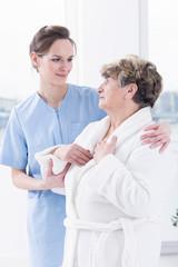 Senior woman and her nurse