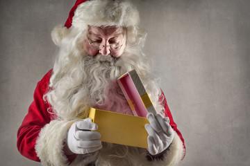 Santa Claus opening the box