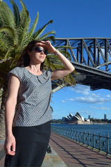 Woman traveller watch the sunset from Sydney Harbour Bridge