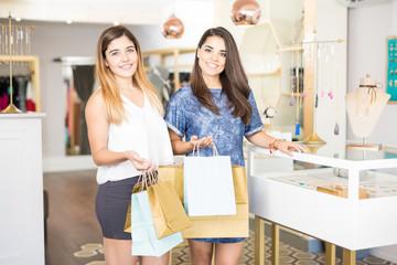 Hispanic female friends shopping together