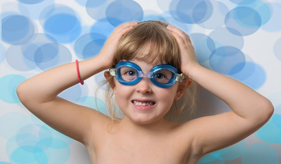 girl in blue glasses for a scuba diving