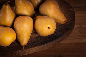 Fresh Ripe Organic Pears on a Wooden Table. Selective focus.
