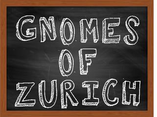 GNOMES OF ZURICH handwritten text on black chalkboard