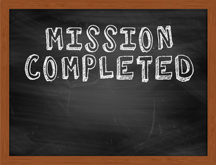 MISSION COMPLETED handwritten text on black chalkboard