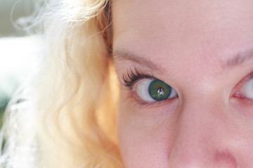 Green eyed blonde looking at you.