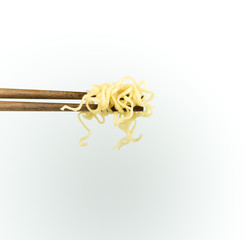 chopsticks noodles isolated on white background