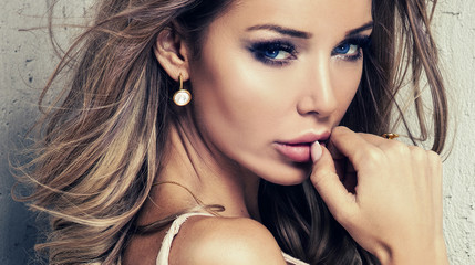 Sexy woman with glamour makeup.