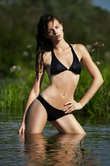 Young brunette in water