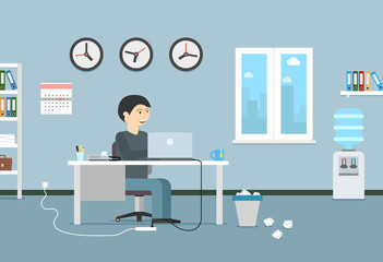 Happy businessman working with laptop. Office interior and workplace