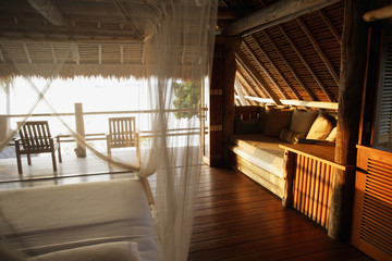 tropical bedroom, bed with net curtain