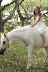 young girl riding bareback on pony