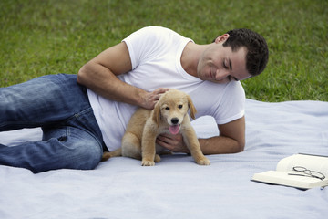 man at park with puppy