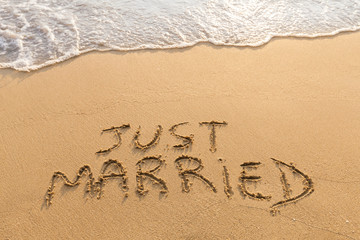 Just married written in the sand, tropical beach, honeymoon travel