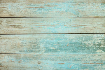 Old weathered wood plank painted in blue