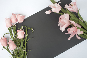 Flat lay composition with text place and flowers. Romantic photo background.