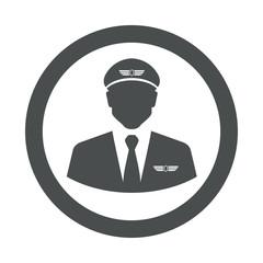 Icono plano silueta piloto aviacion en circulo color gris