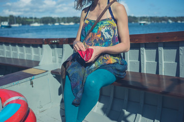Woman in boat with a purse