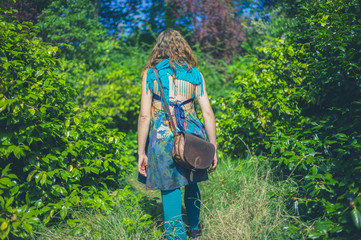 Woman wearing unusual outfit in forest