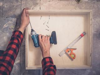 Carpenter building a drawer