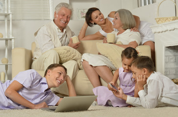 Happy family with kids with laptop