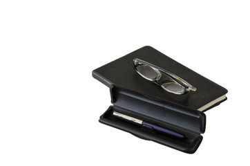 Business notebook, glasses and pen