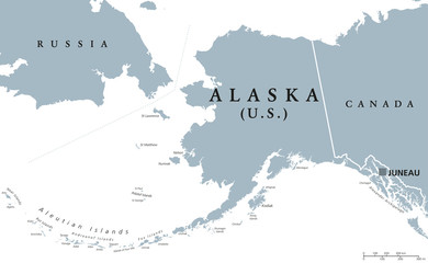 Alaska political map with capital Juneau. U.S. state in the northwest of the Americas with international borders and neighbor countries Russia and Canada. Gray colored illustration. English labeling.