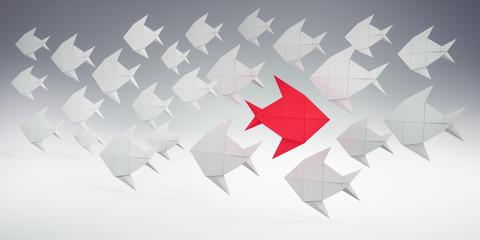 Papierfisch-Schwarm mit rotem Einzelgänger