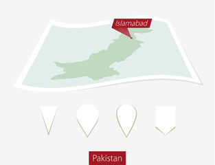Curved paper map of Pakistan with capital Islamabad  on Gray Background. Four different Map pin set.