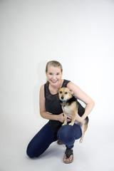 Mature Blonde Female Holding Dog