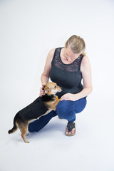 Blonde Female Playing With Dog
