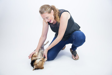 Mature Blonde Female Playing With Dog