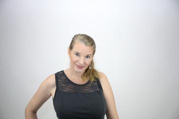 Mature Blonde Female Facing Camera Torso Shot