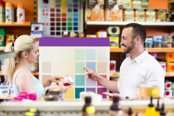 Man and woman picking paint color